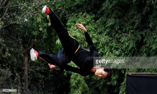 Indian Bollywood film actor Tiger Shroff performs live action Parkour stunts for promotion of his Hindi film 'Heropanti' in Mumbai on May 19 2014 AFP...