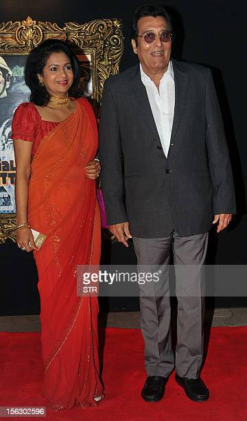 Indian Bollywood film actor Vinod Khanna and his wife Kavita pose on the red carpet at the premiere of the Hindi film 'Jab Tak Hai Jaan' in Mumbai on...