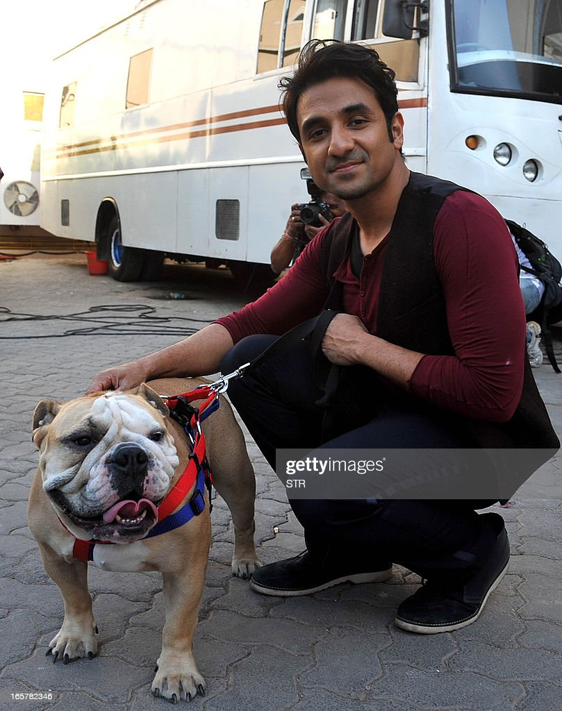 Indian Bollywood film actor Vir Das poses with his pet during the press meet for the promotion of the upcoming Hindi Film 'Go Goa Gone' directed by Raj Nidimoru and Krishna D K in Mumbai on April 5, 2013.