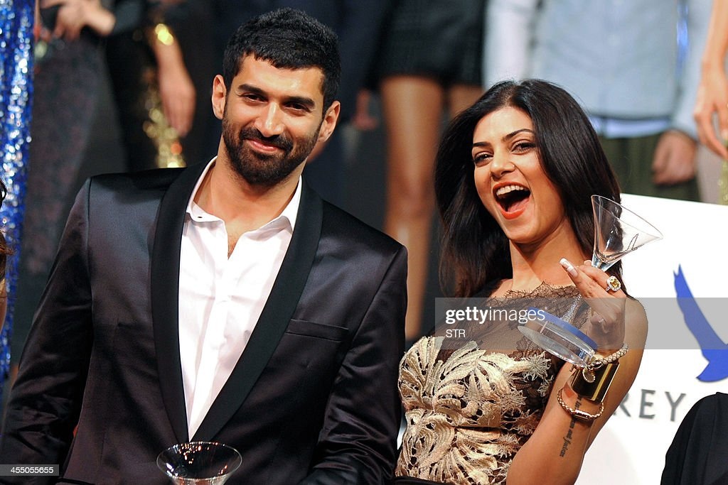 Indian Bollywood film actors Aditya Roy Kapur (L) and Sushmita Sen pose during the 'Grey Goose Style Du Jour' Spring-Summer collection fashion show in Mumbai on December 10, 2013.