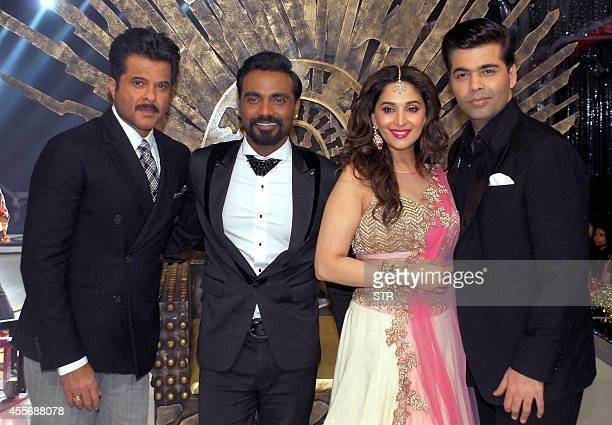 Indian Bollywood film actors Anil Kapoor as guest choreographerdirector Remo D'Souza film actress Madhuri Dixhit and director Karan Johar pose during...