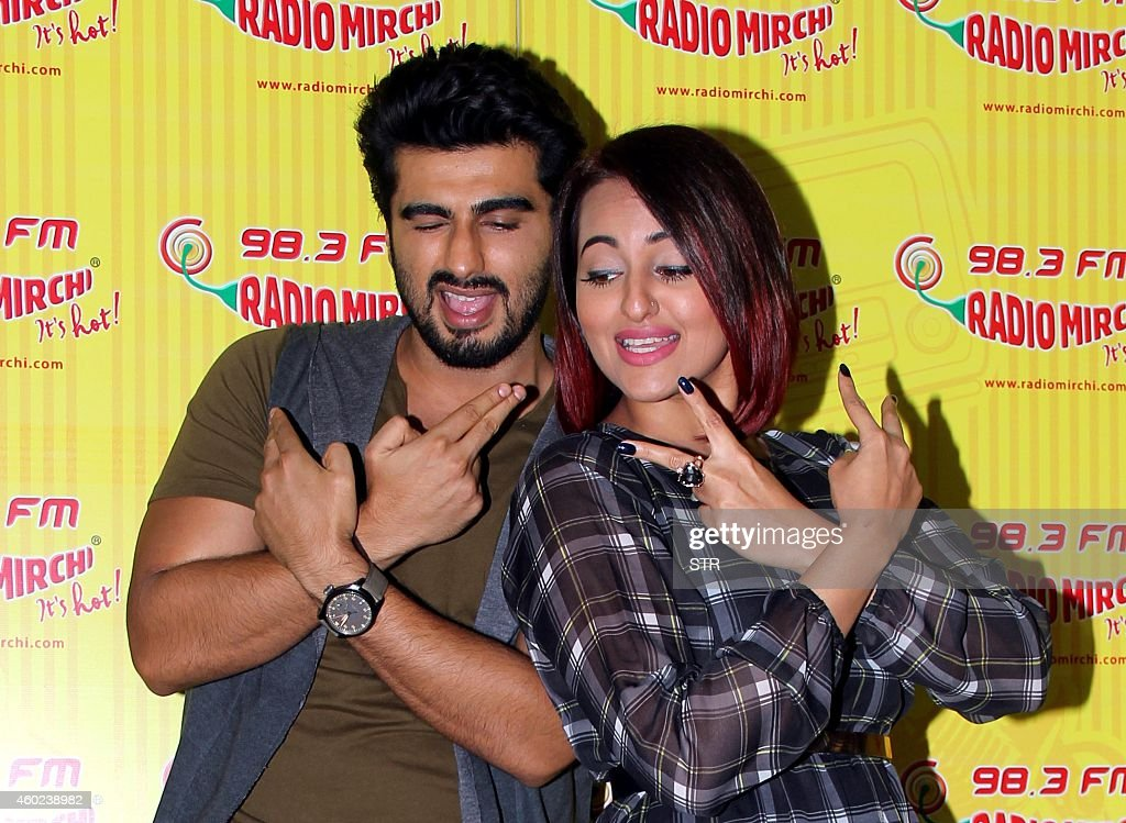Indian Bollywood film actors <a gi-track='captionPersonalityLinkClicked' href=/galleries/search?phrase=Arjun+Kapoor&family=editorial&specificpeople=6147223 ng-click='$event.stopPropagation()'>Arjun Kapoor</a> (L) and <a gi-track='captionPersonalityLinkClicked' href=/galleries/search?phrase=Sonakshi+Sinha&family=editorial&specificpeople=5781347 ng-click='$event.stopPropagation()'>Sonakshi Sinha</a> pose during the promotion of the Hindi film 'Tevar' at 98.3 FM studios in Mumbai on December 10, 2014.