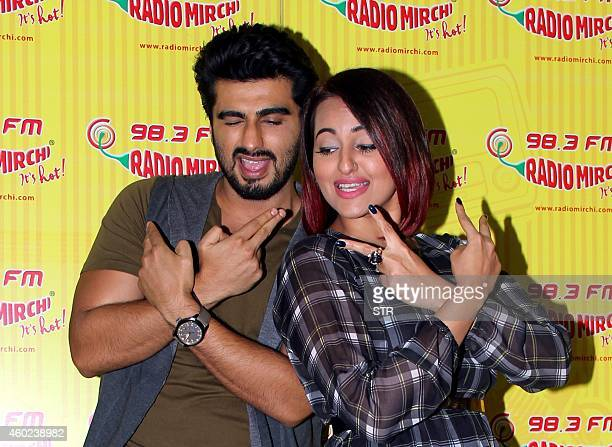 Indian Bollywood film actors Arjun Kapoor and Sonakshi Sinha pose during the promotion of the Hindi film 'Tevar' at 983 FM studios in Mumbai on...