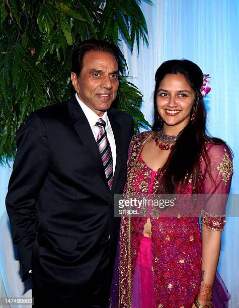 Indian Bollywood film actors Dharmendra and daughter Ahana Deo pose during the wedding reception of Dharmendra's daughter Esha Deol and husband...