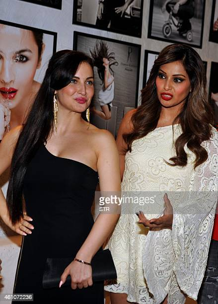 Indian Bollywood film actors Elli Avram and Bipasha Basu pose during the launch of Daboo Ratnani's Celebrity Calendar 2015 in Mumbai on January 5...