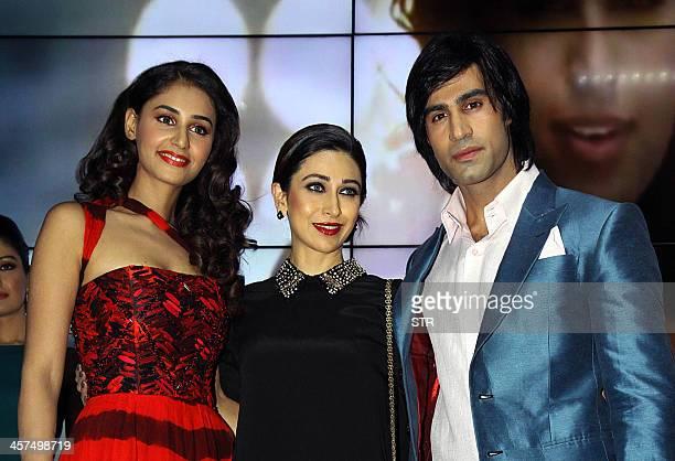 Indian Bollywood film actors Hasleen Kaur Karisma Kapoor and Shiv Darshan attend the music launch of upcoming Hindi film 'Karle Pyaar Karle' directed...