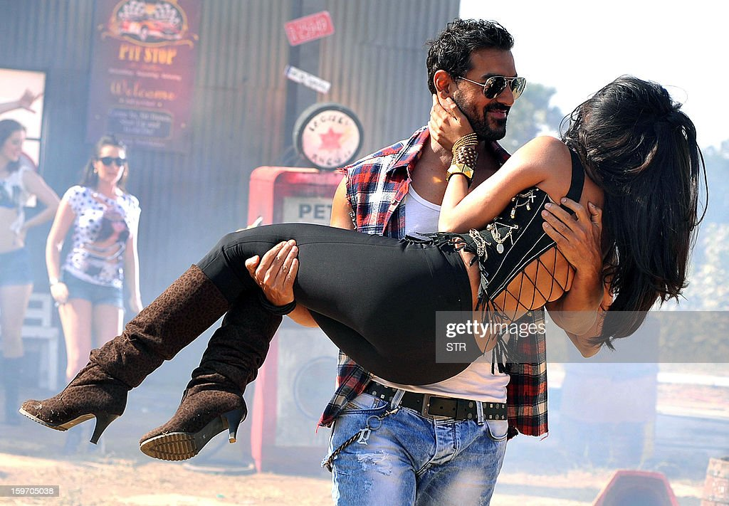 Indian Bollywood film actors John Abraham (L) and Chitrangda Singh perform on location during the shooting of the upcoming Hindi film 'I Me Aur Main' song directed by debutant Kapil Sharma at Kamalistan Studio in Mumbai on January 18, 2013. AFP PHOTO