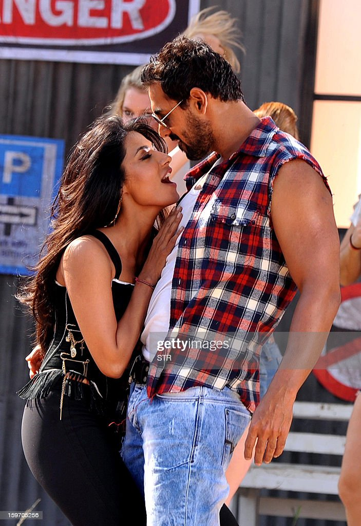 Indian Bollywood film actors John Abraham (R) and Chitrangda Singh perform on location during the shooting of the upcoming Hindi film 'I Me Aur Main' song directed by debutant Kapil Sharma at Kamalistan Studio in Mumbai on January 18, 2013. AFP PHOTO