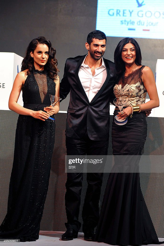 Indian Bollywood film actors Kangana Ranaut, (L), Aditya Roy Kapur (C) and Sushmita Sen pose during the 'Grey Goose Style Du Jour' Spring-Summer collection fashion show in Mumbai on December 10, 2013.