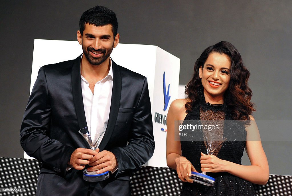 Indian Bollywood film actors Kangana Ranaut (L) and Aditya Roy Kapur pose during the 'Grey Goose Style Du Jour' Spring-Summer collection fashion show in Mumbai on December 10, 2013.