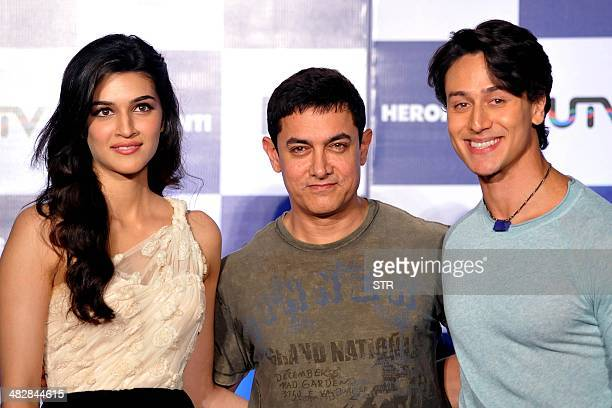 Indian Bollywood film actors Kriti Sanon Amir Khan and Tiger Shroff pose during the launch of the trailer of the upcoming Hindi film 'Heropanti'...