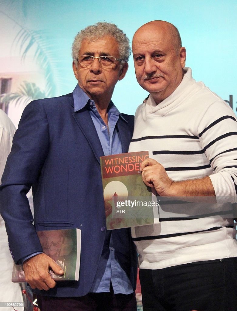 Indian Bollywood film actors Naseeruddin Shah and Anupam Kher pose during the book launch of 'Witnessing Wonders' by journalist Ali Peter John...
