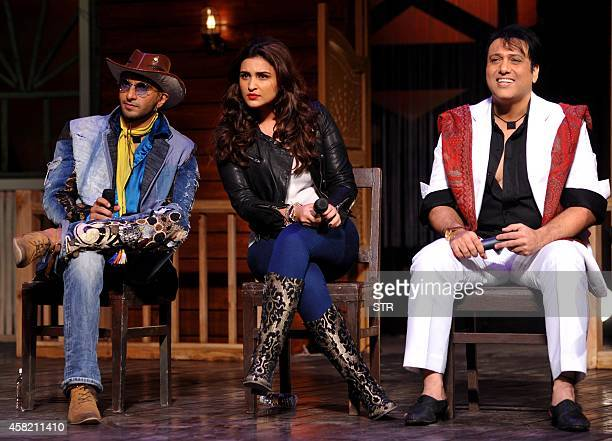 Indian Bollywood film actors Ranveer Singh Parineeti Chopra and Govinda listen during the promotion of the upcoming Hindi film 'Kill/Dil' directed by...