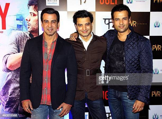 Indian Bollywood film actors Rohit Roy Rahul Bhatt and Ronit Roy pose at the premier of Hindi Film 'Ugly' written and directed by Anurag Kashyap in...