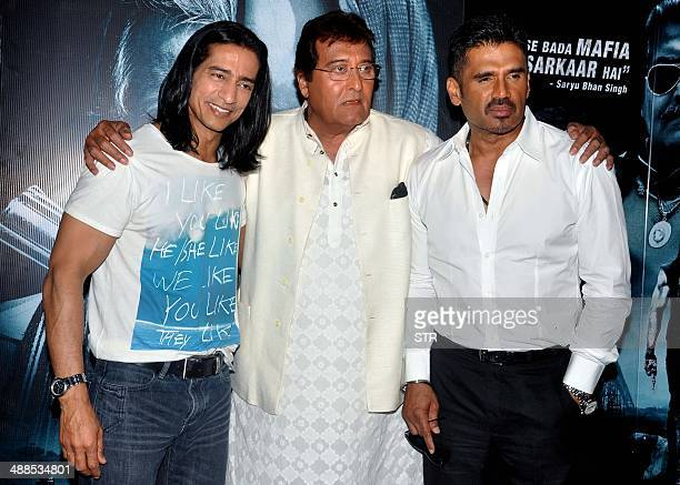 Indian Bollywood film actors Vipinno Vinod Khanna and Suniel Shetty pose during the promotion and press conference of the upcoming Hindi film...