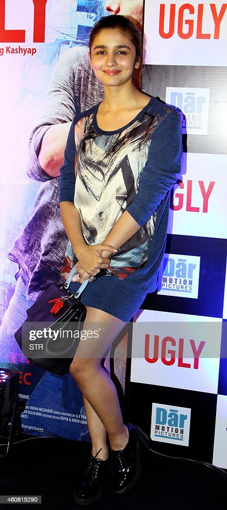 Indian Bollywood film actress <a gi-track='captionPersonalityLinkClicked' href=/galleries/search?phrase=Alia+Bhatt&family=editorial&specificpeople=9620703 ng-click='$event.stopPropagation()'>Alia Bhatt</a> poses at the premier of Hindi Film 'Ugly' written and directed by Anurag Kashyap, in Mumbai on December 23, 2014.