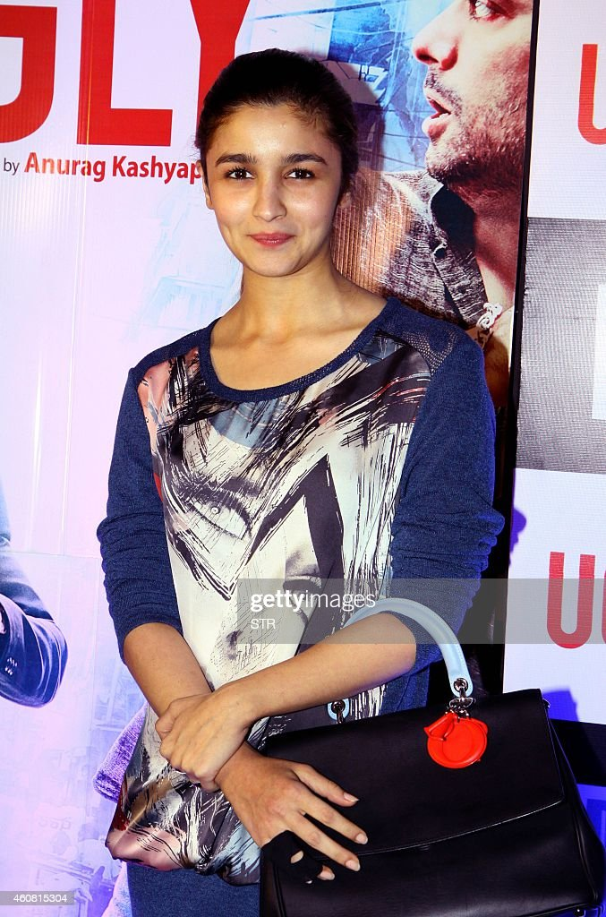 Indian Bollywood film actress <a gi-track='captionPersonalityLinkClicked' href=/galleries/search?phrase=Alia+Bhatt&family=editorial&specificpeople=9620703 ng-click='$event.stopPropagation()'>Alia Bhatt</a> poses at the premier of Hindi Film 'Ugly' written and directed by Anurag Kashyap, in Mumbai on December 23, 2014. AFP PHOTO