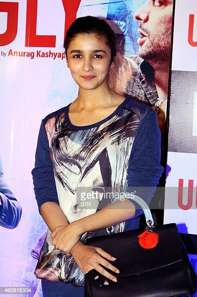 Indian Bollywood film actress Alia Bhatt poses at the premier of Hindi Film 'Ugly' written and directed by Anurag Kashyap in Mumbai on December 23...
