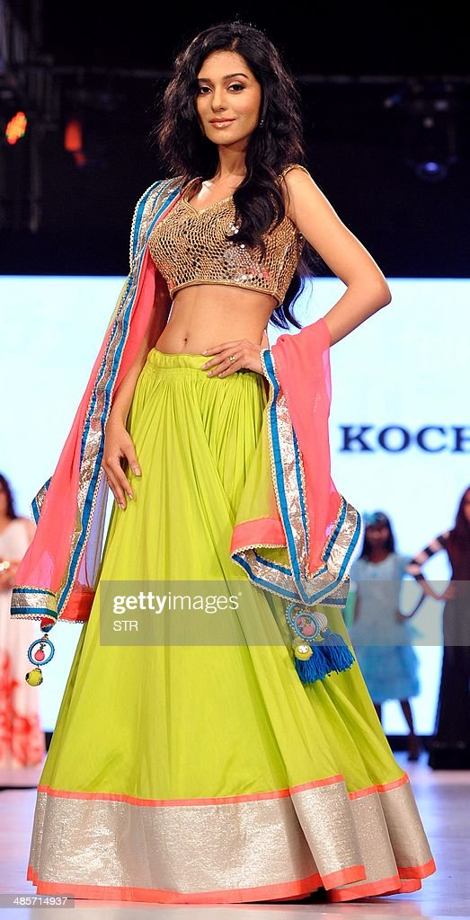 Indian Bollywood film actress <a gi-track='captionPersonalityLinkClicked' href=/galleries/search?phrase=Amrita+Rao&family=editorial&specificpeople=3080005 ng-click='$event.stopPropagation()'>Amrita Rao</a> showcases a creation by designer Archana Kohhar during the fifth edition of the Smile Foundation charity fashion show 'Ramp for Champs' to raise support for the education of the girl child, in Mumbai on April 19, 2014. AFP PHOTO