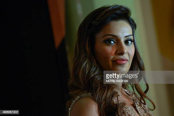 Indian Bollywood film actress Bipasha Basu looks on during a press briefing for the 16th International Indian Film Awards at a hotel in Kuala Lumpur...