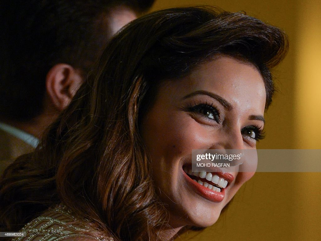 Indian Bollywood film actress <a gi-track='captionPersonalityLinkClicked' href=/galleries/search?phrase=Bipasha+Basu&family=editorial&specificpeople=695956 ng-click='$event.stopPropagation()'>Bipasha Basu</a> smiles as she speaks during a press briefing for the 16th International Indian Film Awards (IIFA) at a hotel in Kuala Lumpur on April 9, 2015. Malaysia has been choosen as the destination for the 16th International Indian Film Awards (IIFA) on June 5-7.