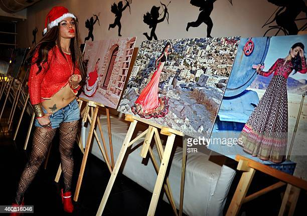 Indian Bollywood film actress dancer item girl and politician Rakhi Sawant poses during the launch of the 'Telly Calendar 2015' in Mumbai on December...