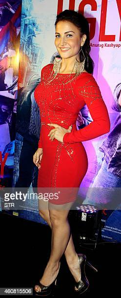 Indian Bollywood film actress Elli Avram poses at the premier of Hindi Film 'Ugly' written and directed by Anurag Kashyap in Mumbai on December 23...