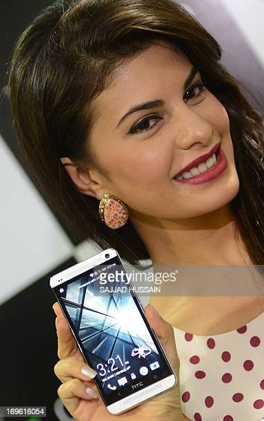 Indian Bollywood film actress Jacqueline Fernandez displays the newly launched new HTC One smartphone at a function in New Delhi on May 29 2013 The...