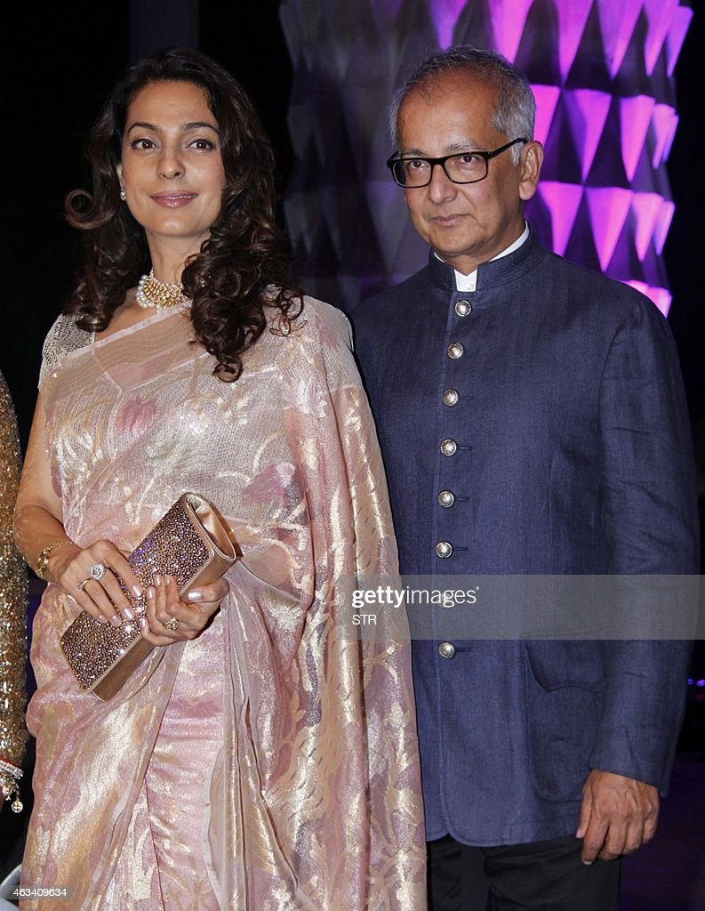 Indian Bollywood film actress <a gi-track='captionPersonalityLinkClicked' href=/galleries/search?phrase=Juhi+Chawla&family=editorial&specificpeople=2849898 ng-click='$event.stopPropagation()'>Juhi Chawla</a> (L) and husband Jay Mehta attend the wedding reception of Bollywood film producer Smita Thackeray's son, Rahul Thackeray and his wife, Aditi in Mumbai on February 13, 2015.