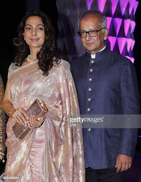 Indian Bollywood film actress Juhi Chawla and husband Jay Mehta attend the wedding reception of Bollywood film producer Smita Thackeray's son Rahul...