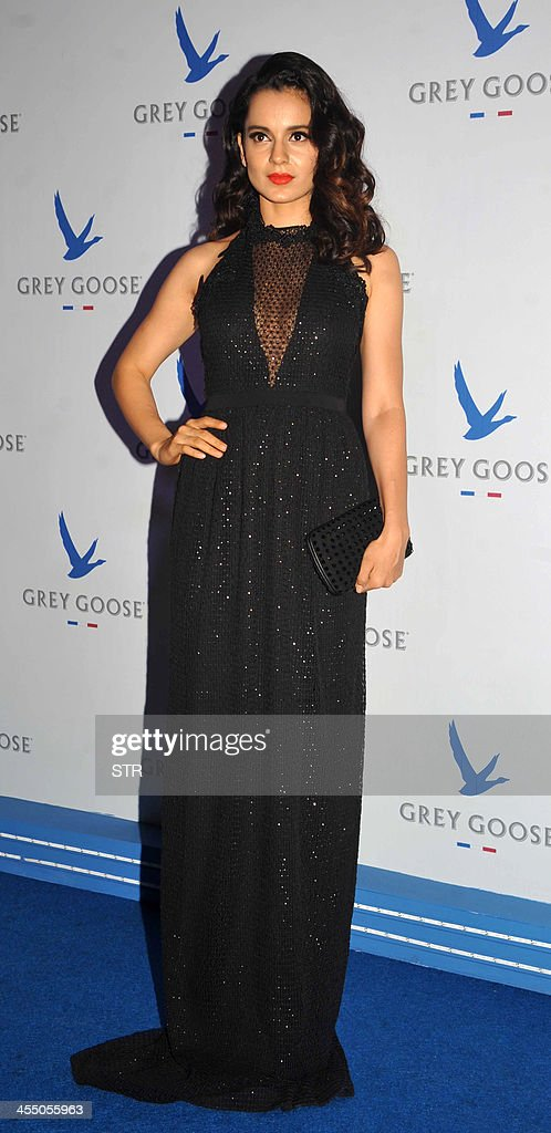 Indian Bollywood film actress Kangana Ranaut poses during the 'Grey Goose Style Du Jour' Spring-Summer collection fashion show in Mumbai on December 10, 2013.