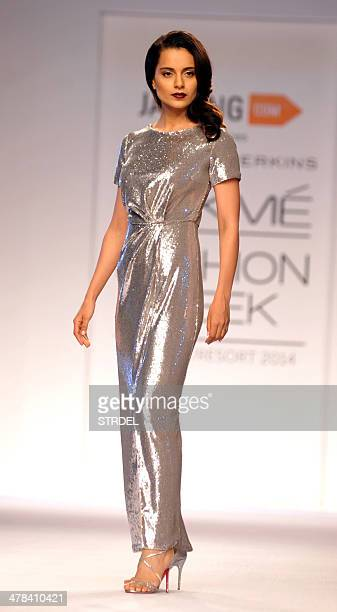Indian Bollywood film actress Kangana Ranaut showcases a creation by Jabong on the third day of the Lakme Fashion Week summer/resort 2014 in Mumbai...