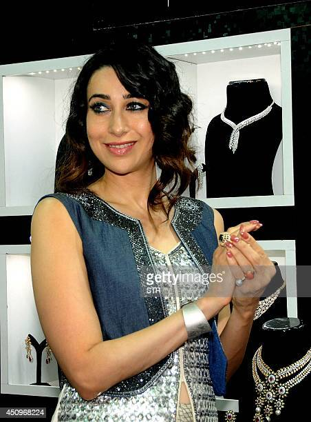 Indian Bollywood film actress Karisma Kapoor poses during the inauguration of The Jewellery Exhibition spearheaded by Bulbeer Gandhi and Sumit Gandhi...