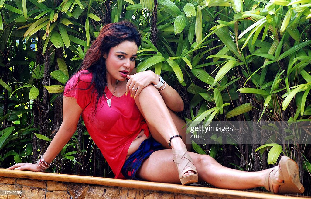 Indian Bollywood film actress Kavita Verma poses during the promotion of the item song and photo shoot of upcoming Hindi film 'Policegiri' directed by K.S. Ravikumar and produced by T.P. and Rahul Aggarwal in Mumbai on June 12, 2013.