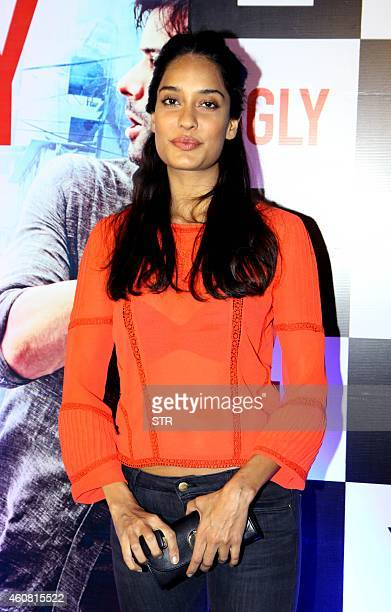 Indian Bollywood film actress Lisa Haydon poses at the premier of Hindi Film 'Ugly' written and directed by Anurag Kashyap in Mumbai on December 23...