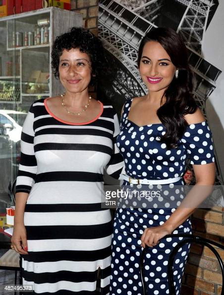 Indian Bollywood film actress Manisha Koirala and Sonakshi Sinha pose during the launch of the covers of health magazines in Mumbai on April 3 2014...