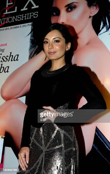 Indian Bollywood film actress Minissha Lamba poses during the unveiling of the magazine cover of the special issue 'Maxim Sex' in Mumbai on August 29...