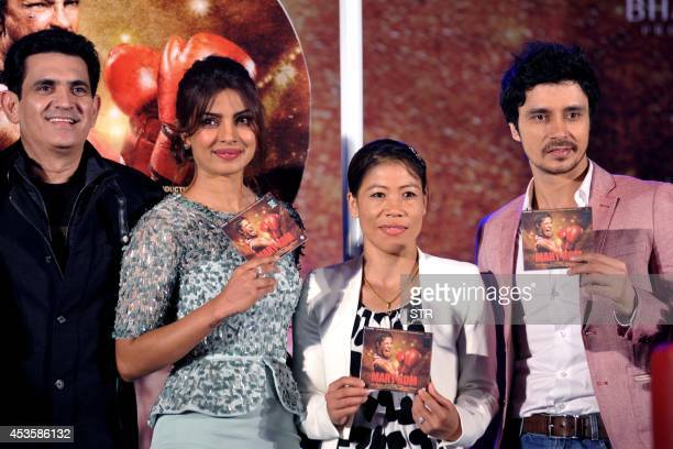 Indian Bollywood film actress Priyanka Chopra Indian woman boxer Mary Kom and Sunil Thapa pose during the music launch of the upcoming Indian...