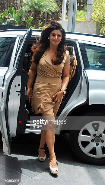 Indian Bollywood film actress Raveena Tandon arrives for a product promotion event in Mumbai on June 11 2013 AFP PHOTO