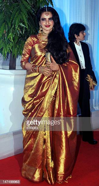Indian Bollywood film actress Rekha poses during the wedding reception ceremony of film actress Esha Deol and husband Bharat Takhtani in Mumbai on...
