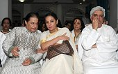 Indian Bollywood film actress Shabana Azmi and poet lyricist and scriptwriter Javed Akhtar join Indian Bhajan maestro Anup Jalota during a prayer...