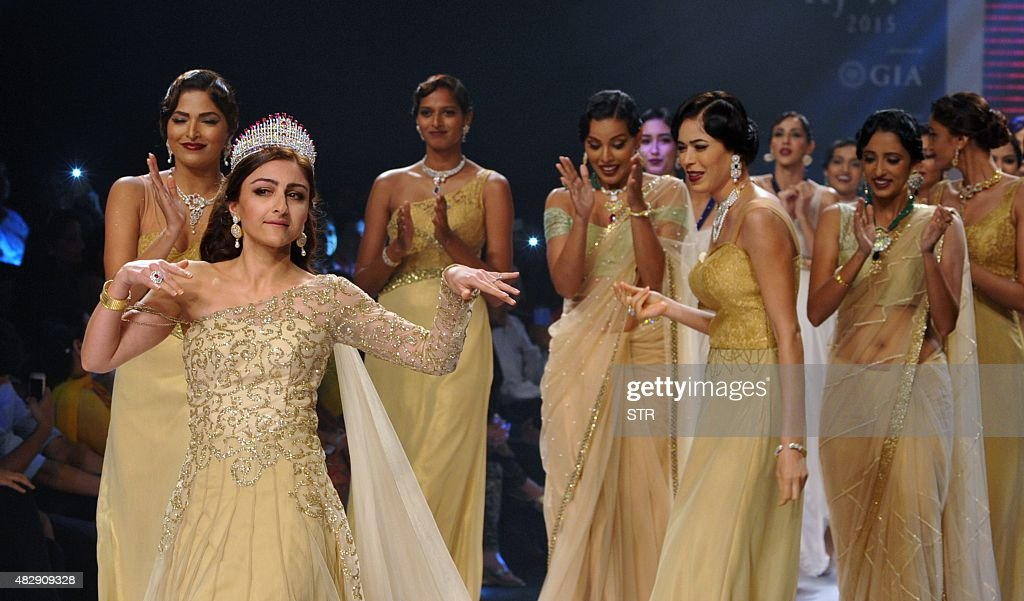 Indian Bollywood film actress Soha Ali Khan showcases a creation during India International Jewellery Week 2015 in Mumbai on August 4 2015 AFP PHOTO