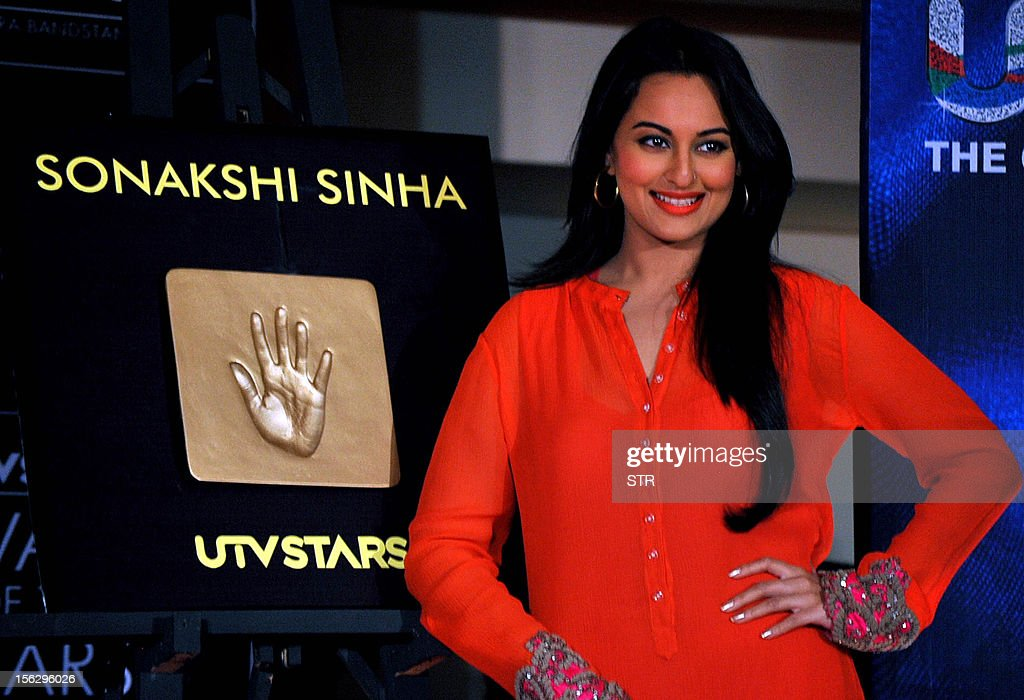 Indian Bollywood film actress Sonakshi Sinha poses during the unveiling of her tile and the promotion of Hindi film 'Son of Sardar' during a celebration of Diwali with UTV Star in Mumbai on November 12, 2012. AFP PHOTO