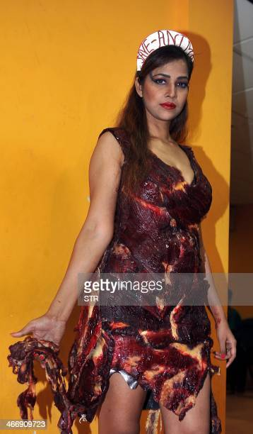 Indian Bollywood film actress Tanisha Singh poses in a real goat meat dress similiar to one worn by Lady Gaga at the 2010 Video Music Awards during a...