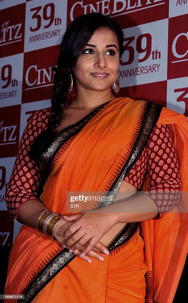 Indian Bollywood film actress Vidya Balan poses during the unveiling of the 39th anniversary issue of Cine Blitz magazine 'Celebrating 100 Years of Hindi Cinema' in Mumbai on April 6, 2013. AFP PHOTO