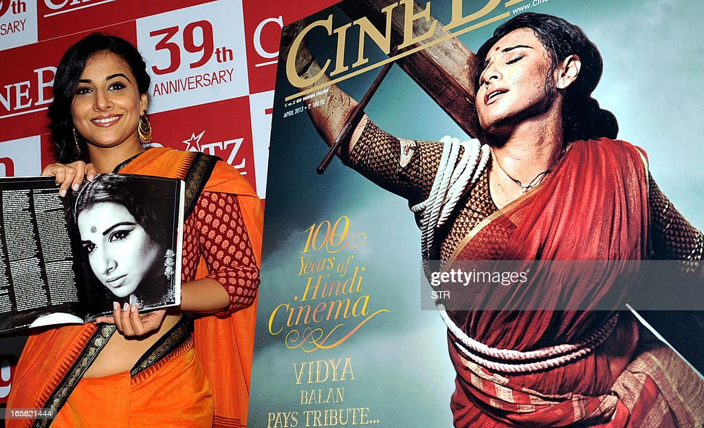 Indian Bollywood film actress Vidya Balan poses during the unveiling of the 39th anniversary issue of Cine Blitz magazine 'Celebrating 100 Years of Hindi Cinema' alongside a poster of the cover featuring herself as 'Mother India' in Mumbai on April 6, 2013. AFP PHOTO