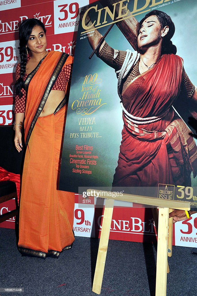 Indian Bollywood film actress Vidya Balan poses during the unveiling of the 39th anniversary issue of Cine Blitz magazine 'Celebrating 100 Years of Hindi Cinema' alongside a poster of the cover featuring herself as 'Mother India' in Mumbai on April 6, 2013.