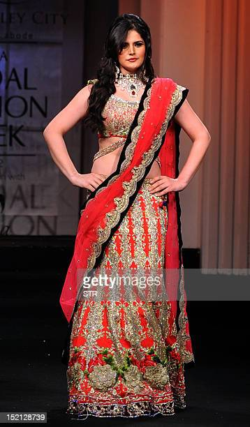 Indian Bollywood film actress Zarine Khan showcases a creation by Indian designer Falguni Shane Peacock on day five of the Aamby Valley India Bridal...