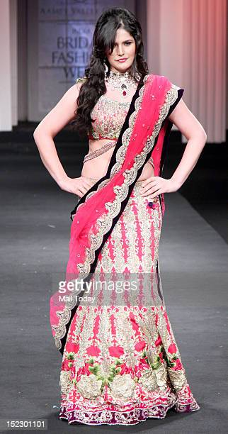 Indian Bollywood film actress Zarine Khan showcases a creation by designer Falguni and Shane Peacock during Aamby Valley India Bridal Fashion Week...