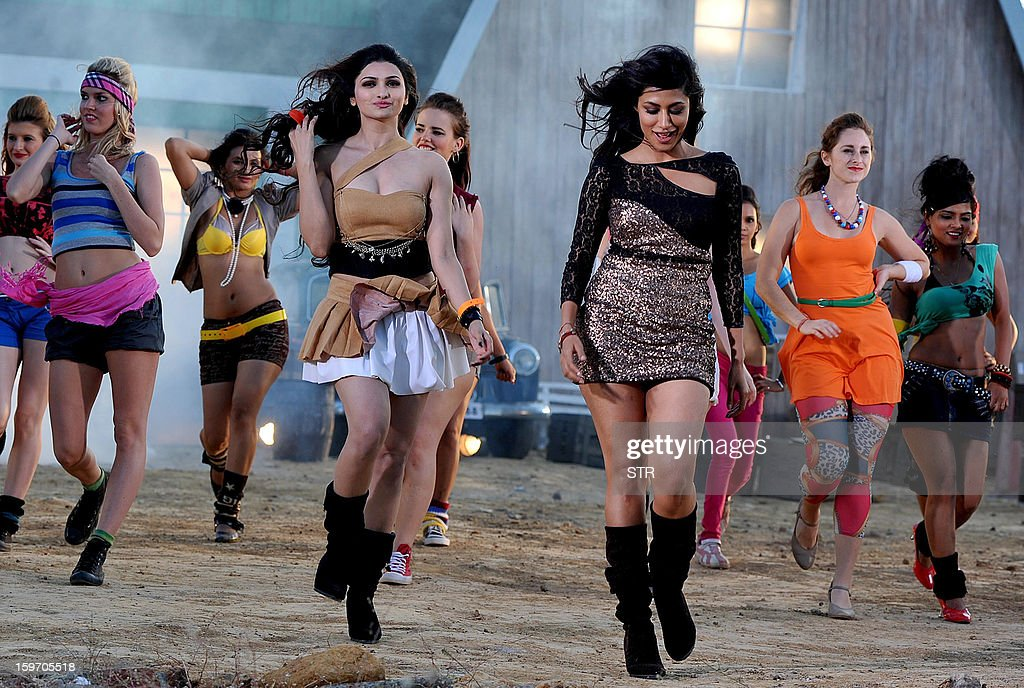 Indian Bollywood film actresses Prachi Desai (C-L) and Chitrangda Singh (C-R) perform on location during the shooting of the upcoming Hindi film 'I Me Aur Main' song directed by debutant Kapil Sharma at Kamalistan Studio in Mumbai on January 18, 2013. AFP PHOTO